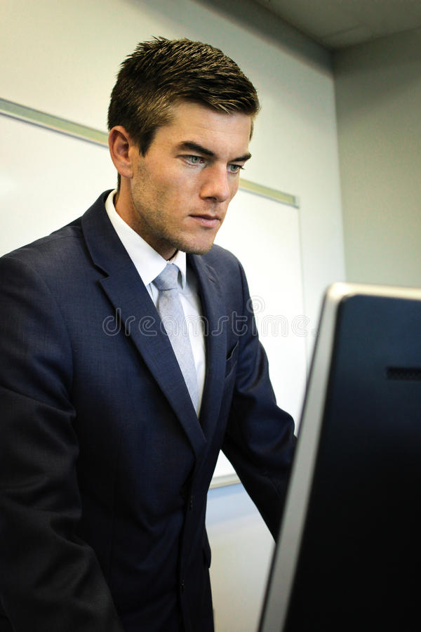 Businessman Looking At Computer stock images