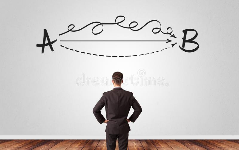 Businessman looking for solution while standing in front of a wall royalty free stock photos