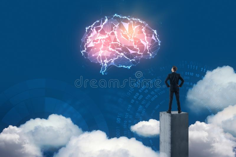 Businessman looking at digital brain. Back view of young businessman looking at abstract glowing polygonal brain on blue background with clouds. Artificial royalty free stock photo