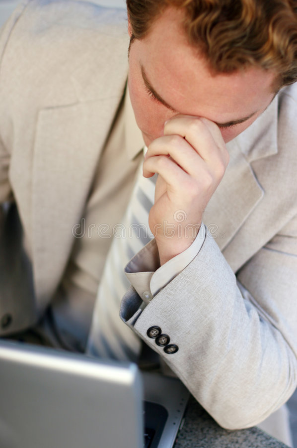 Businessman looking down royalty free stock photography