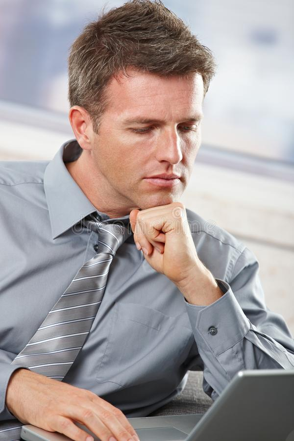 Download Businessman Looking Down At Computer Stock Photo - Image: 12801260