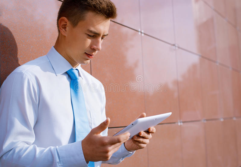 Businessman Looking Down at Tablet Computer stock photos