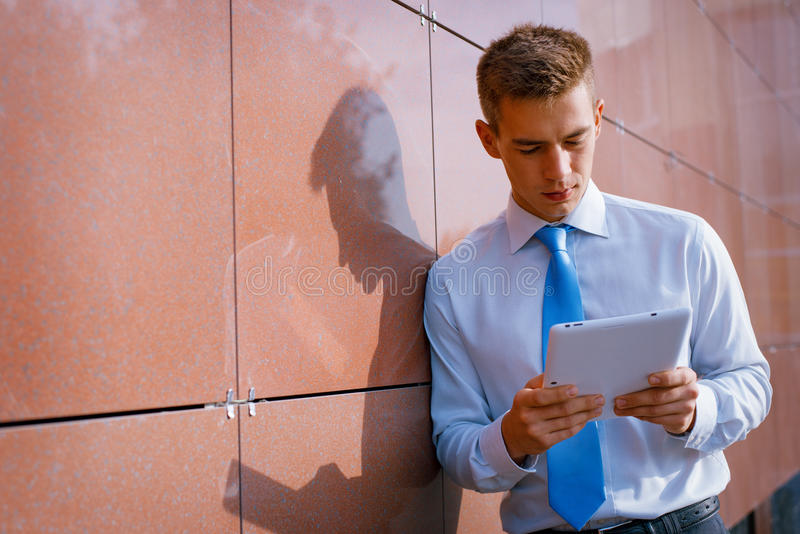 Businessman Looking Down at Tablet Computer stock images