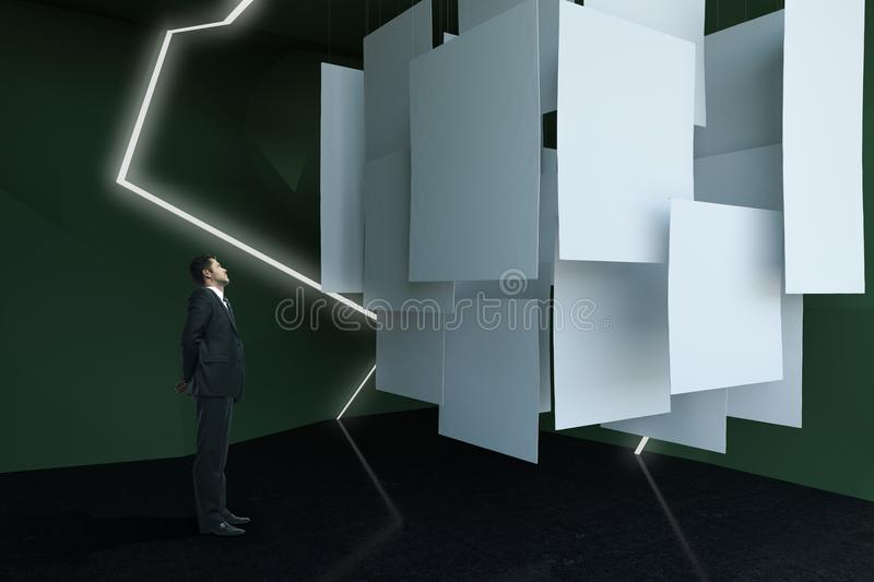 Businessman looking at canvas. Businessman looking at empty canvas in abstract exhibition room. Mock up, 3D Rendering royalty free stock images