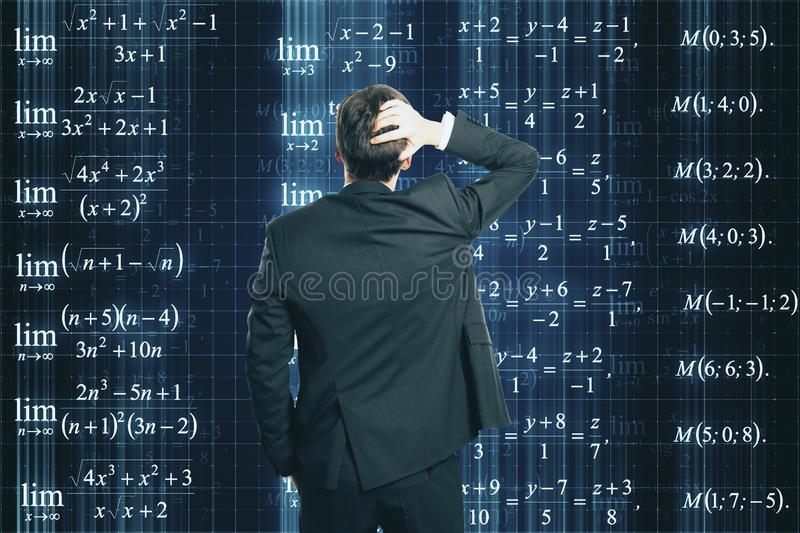 Businessman looking at formulas royalty free stock images
