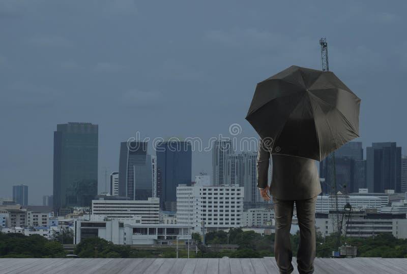 Businessman looking at future city. Businessman standing on wood and looking at future city stock photo