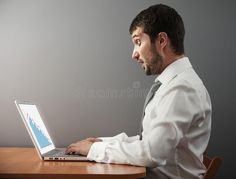 Businessman Looking At Graph Stock Images