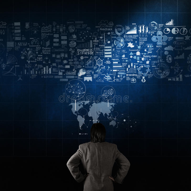 Businessman looking hand drawn business strategy. On texture wall as concept royalty free stock photos