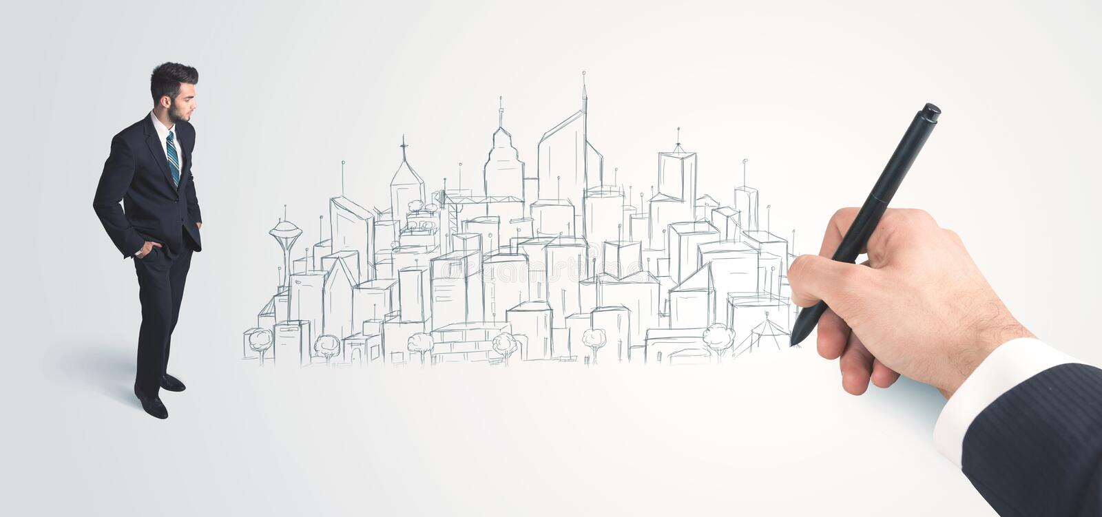 Businessman looking at hand drawn city on wall. Concept on background stock photo
