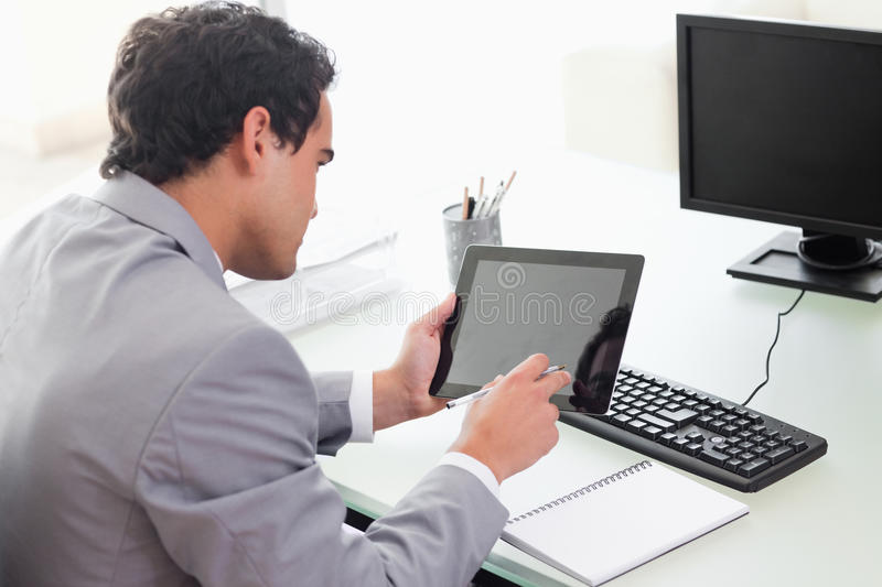 Businessman Looking At His Tablet In His Office Royalty Free Stock Photography