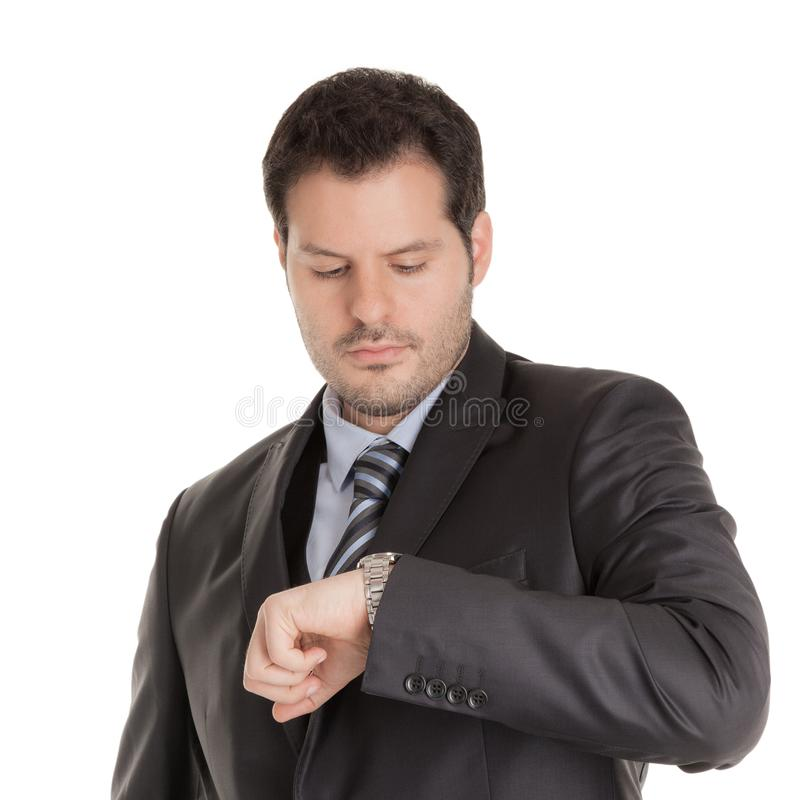 Businessman looking at his watch isolated on white background. Business, time an punctuality concept.  royalty free stock image
