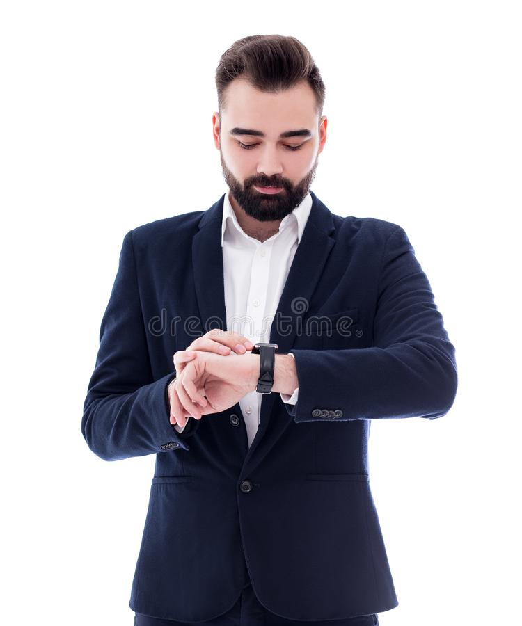 Businessman looking at his watch isolated on white royalty free stock photography
