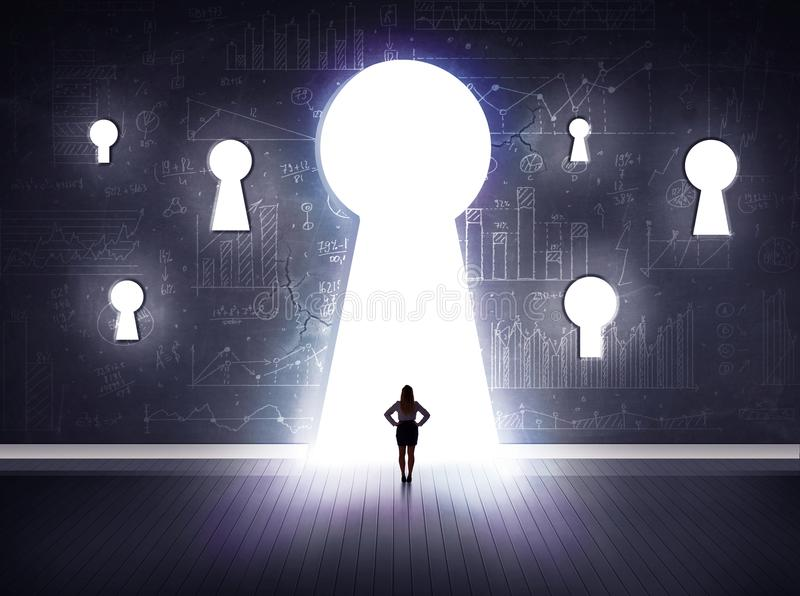 Businessman looking through keyhole. Successful businessman looking through keyhole royalty free stock photo