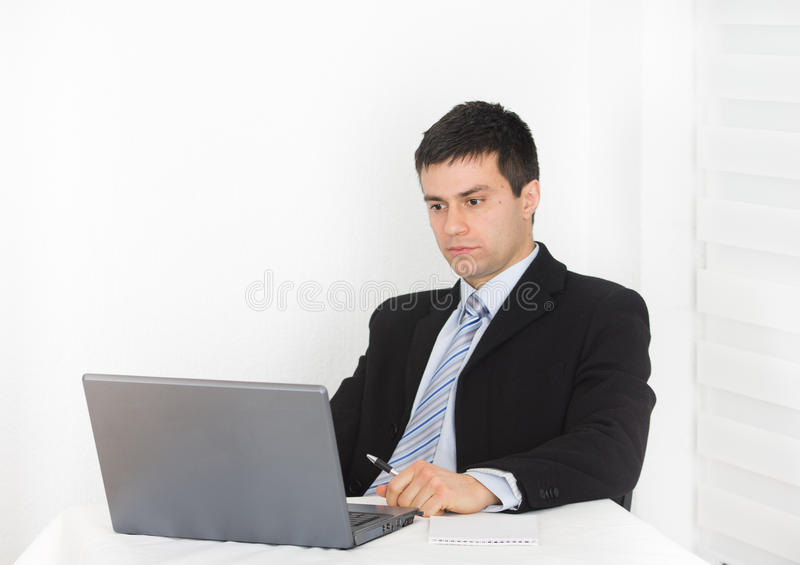 Businessman looking at laptop royalty free stock image