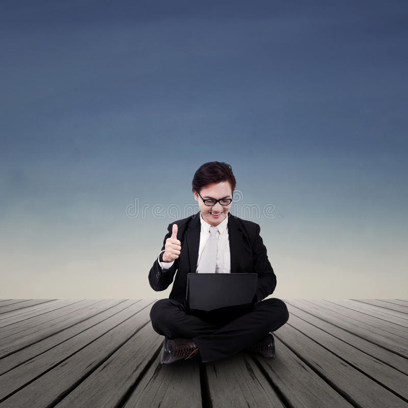 Download Businessman Looking At Laptop Outdoor Stock Image - Image: 43342859