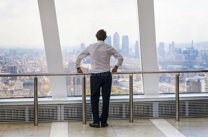 Businessman looking at the London's skyline. royalty free stock photo