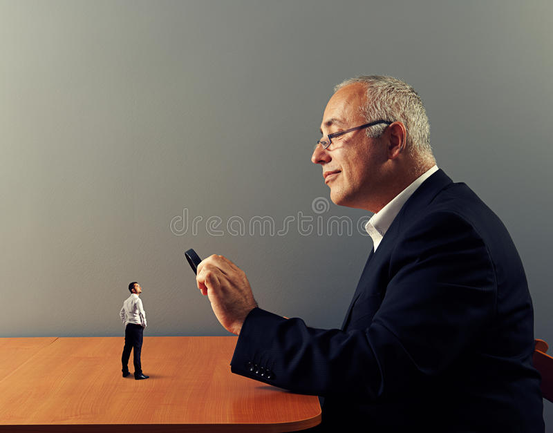 Businessman looking with magnifying glass royalty free stock photos