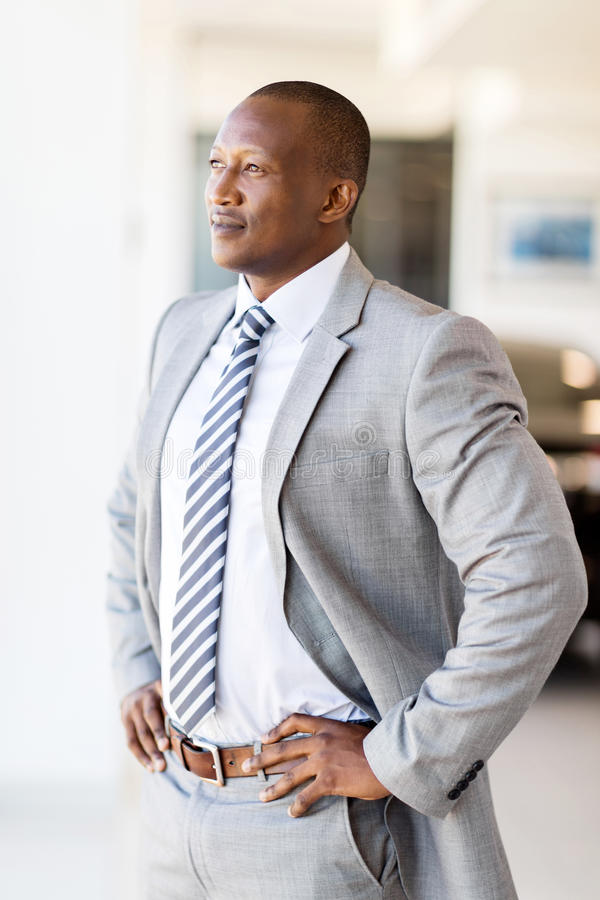 Businessman looking office window. Thoughtful businessman looking through office window royalty free stock image