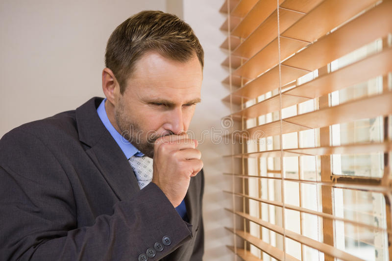 Businessman looking out the window royalty free stock photos