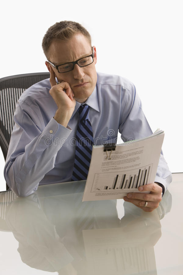 Download Businessman Looking At Paperwork - Isolated Stock Photo - Image: 14645896