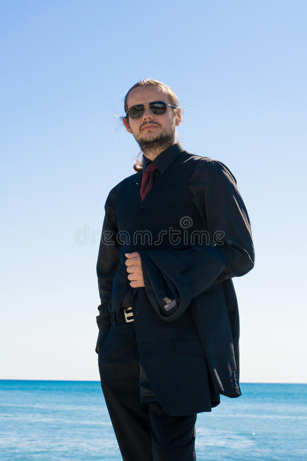 Businessman looking at the photographer royalty free stock image
