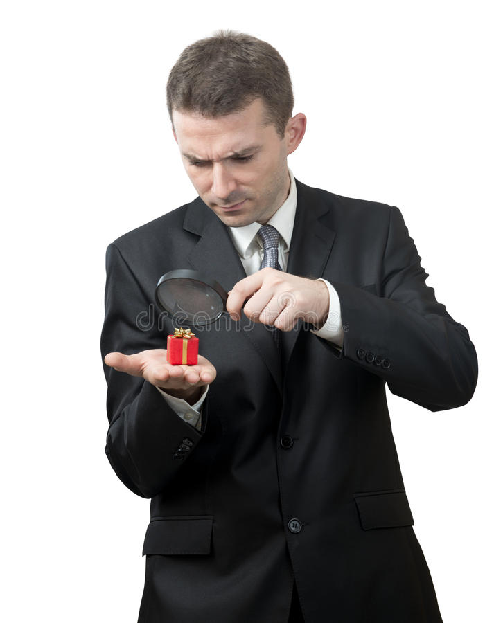 Download Businessman Looking At A Small Present Stock Image - Image of close, broke: 27183269
