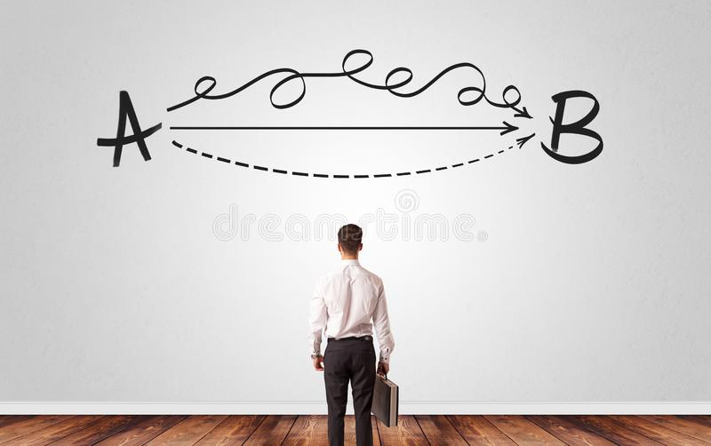 Businessman looking for solution while standing in front of a wall royalty free stock images