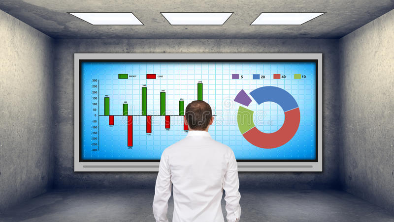 Businessman looking at stock chart. Businessman looking at plasma tv with stock chart royalty free stock images