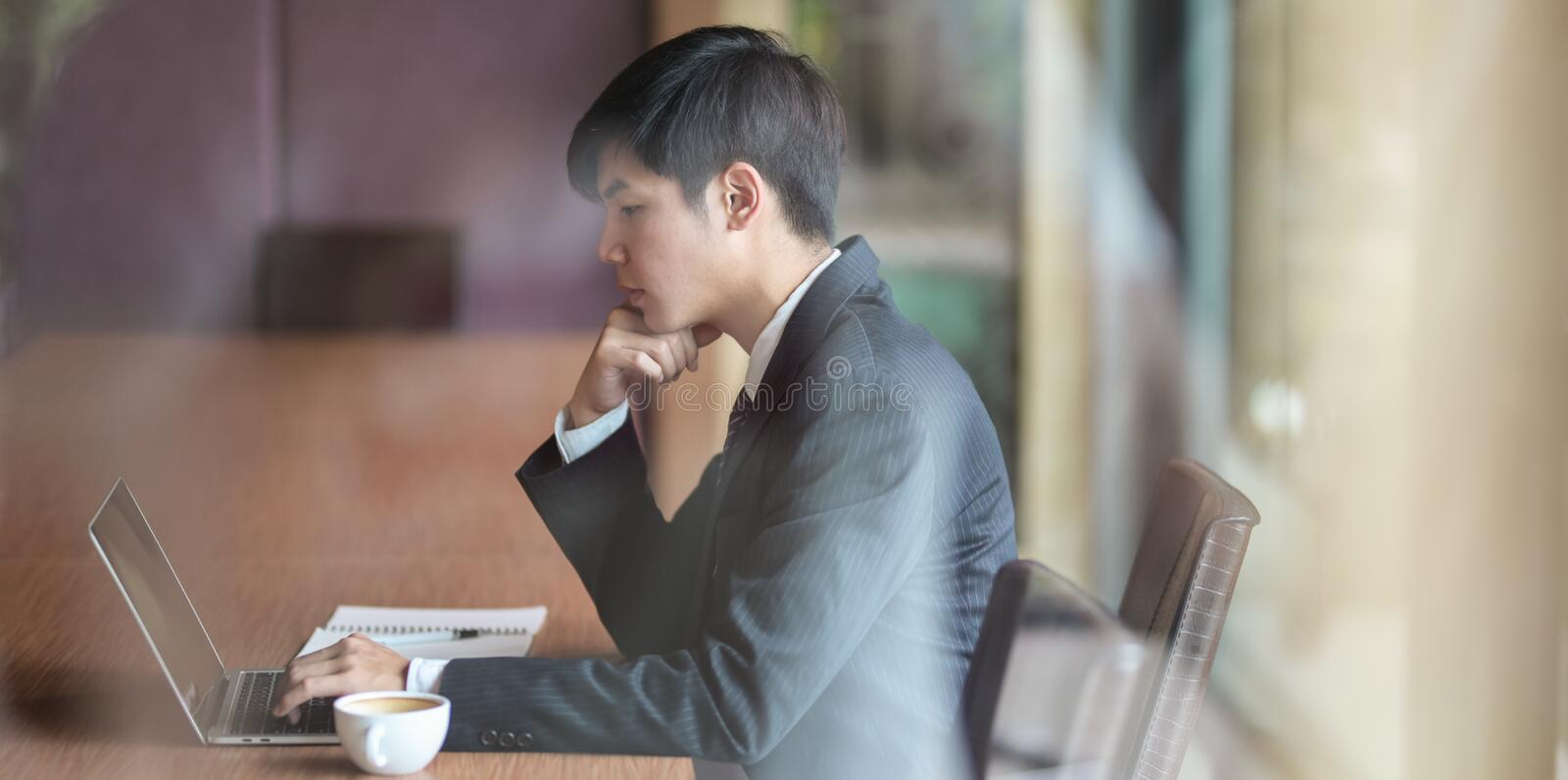 Businessman looking stressful while working on project stock images