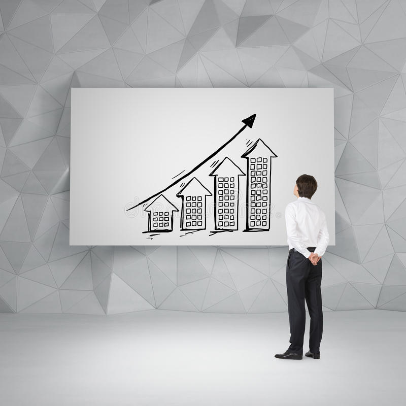 Businessman looking to drawing arrows. Businessman looking to drawing chart and buildings on poster stock images