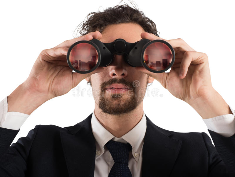 Businessman looking to the future. Businessman looking with binoculars the city. Looking to the future concept stock photography