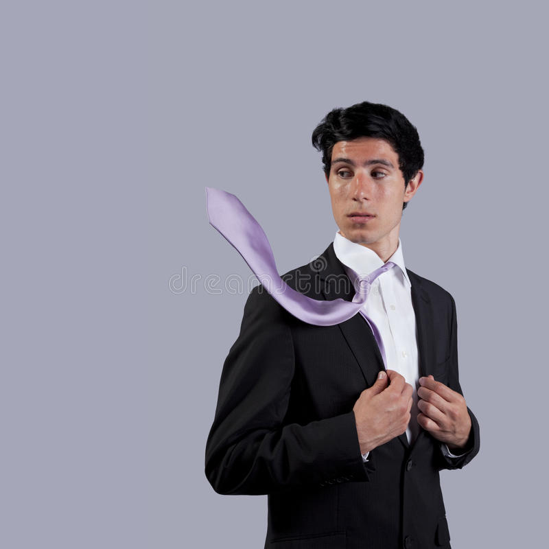Businessman looking to his flying necktie royalty free stock photo