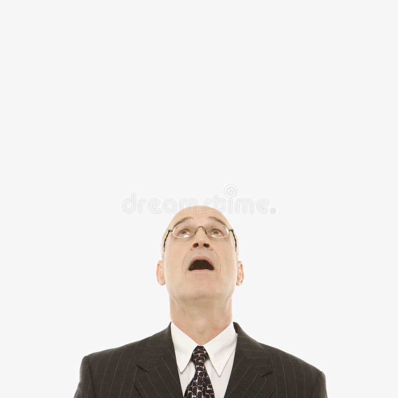 Businessman looking up. stock photography
