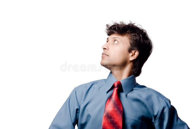 Businessman looking upwards royalty free stock photography