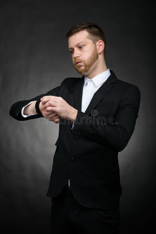 Businessman looking worried at watch stock photography