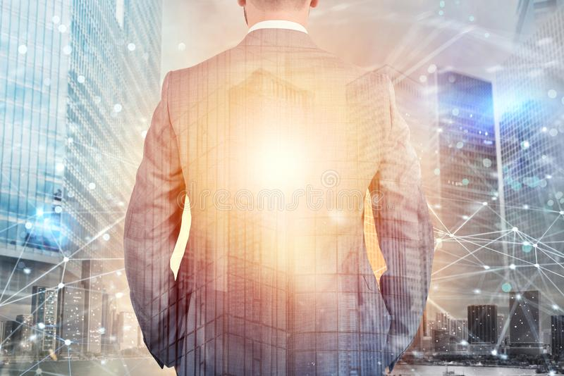 Businessman looks far for the future with internet network effect. Businessman looks far for the future. internet network effect on background stock image