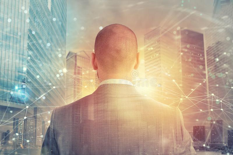 Businessman looks far for the future with internet network effect. Businessman looks far for the future. internet network effect on background royalty free stock photo