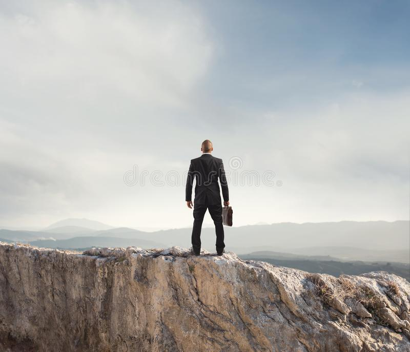 Businessman looks far to the future of the business. On mountain royalty free stock images