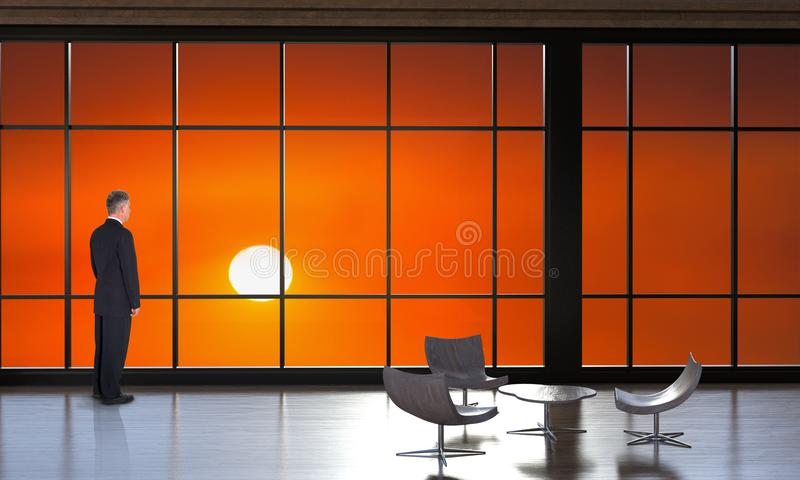 Business, Sales, Marketing, Sunrise, Sunset. A businessman looks out the office window at a sunrise or sunset. The man is a metaphor for business, sales stock photo