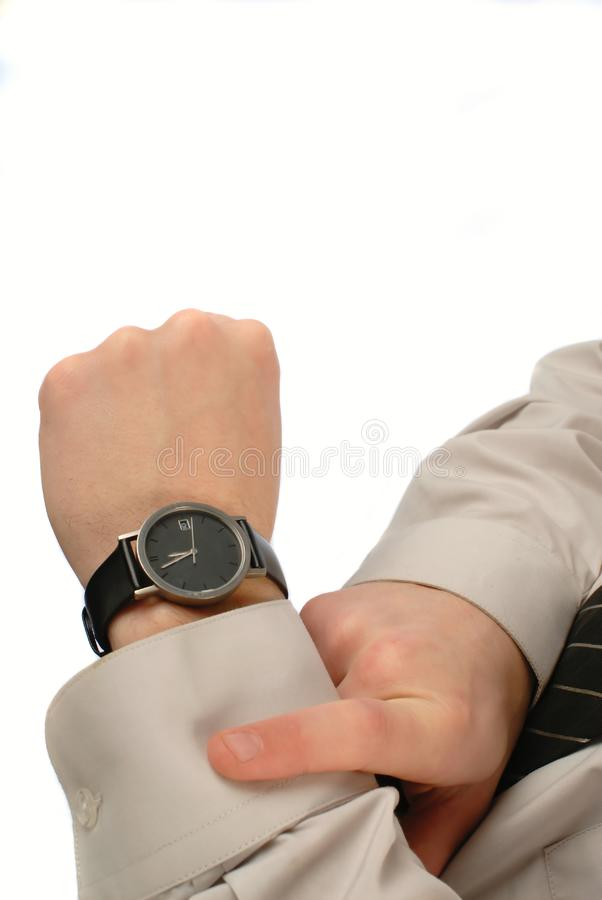Businessman looks time stock photos