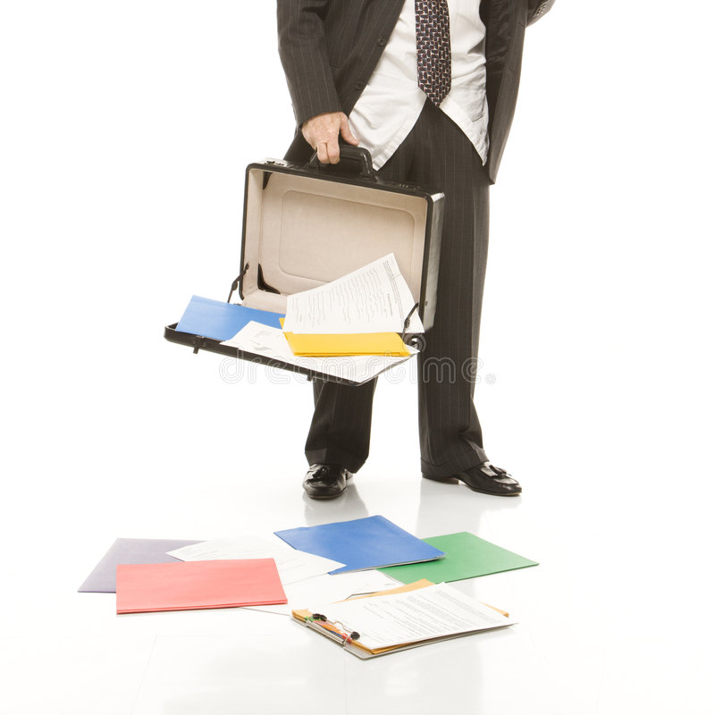 Businessman losing papers stock photography
