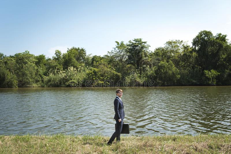 Businessman lost in nature stock images