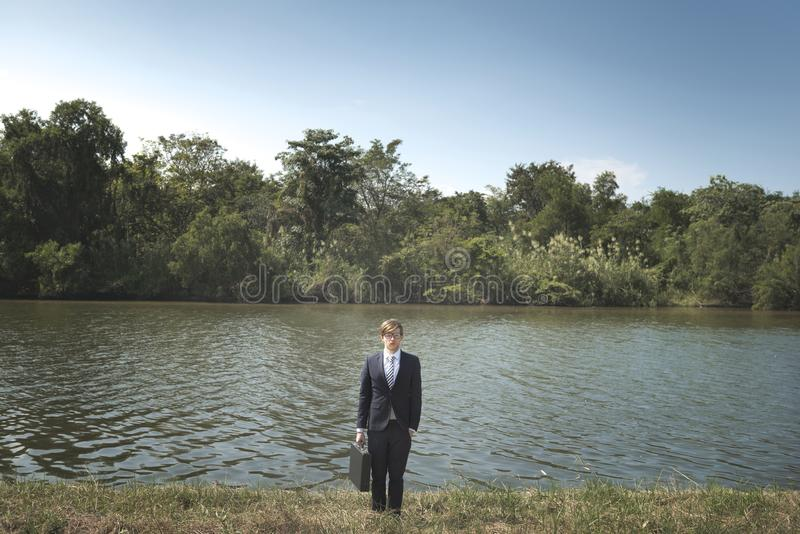 Businessman lost in nature concept royalty free stock photos