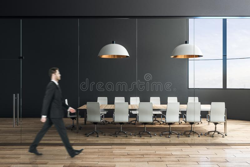 Businessman in luxury conference room stock photography