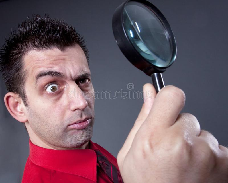 Businessman with magnifying glass royalty free stock photography