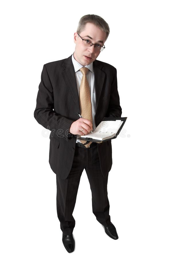 Free Businessman Makes Entry In Notebook Stock Image - 11764271