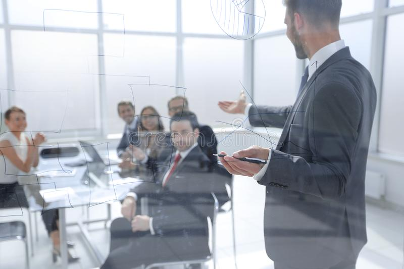 Businessman makes a presentation of a new project in a modern office stock images