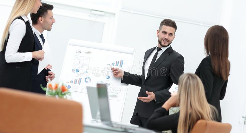 Businessman makes a presentation to his business team stock image