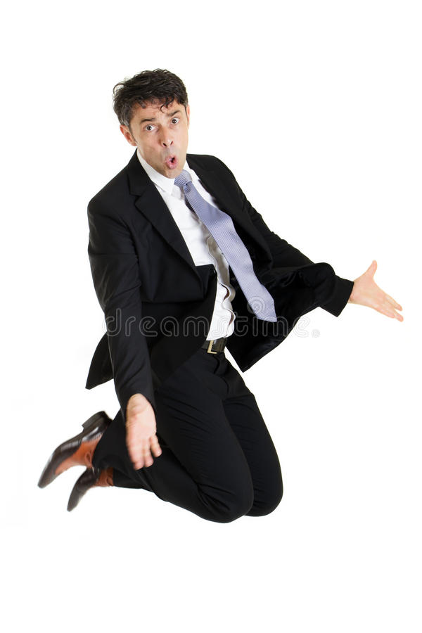 Businessman making an imploring gesture. Businessman making an imploring impassioned gesture with outstretched arms while either kneeling on the floor or leaping royalty free stock image