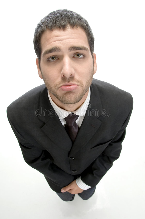 Businessman making poor face royalty free stock image